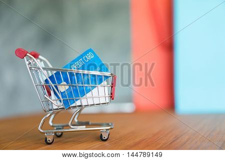 shopping cart and credit card with copy space shopping and business concept soft focus