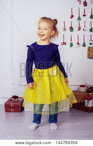 beautiful little girl sings. The concept of New Year and Christmas
