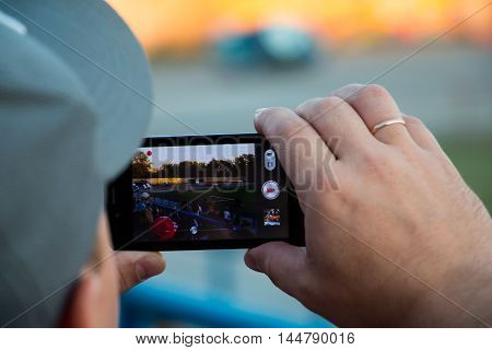 Spectators Are Taking Pictures Of Extreme Auto Show In Kirov City In 2016
