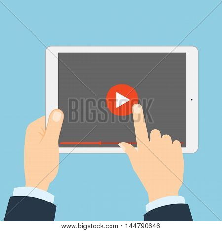Tablet with play button. Hands holding phone and touching play button. Concept of video, audio, internet and games.