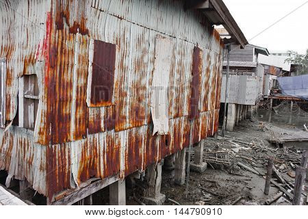 Zinc wall pattern. Rusty corrugated metal wall texture. home Thailand ancient  decay nature