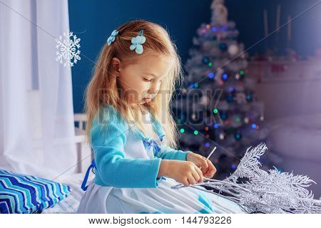 little girl in a dress on New Year's night. The concept of New Year and Christmas