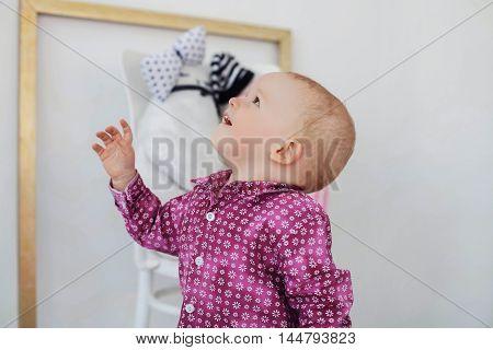 good boy dreamily looking up. portrait, blonde, shirt, fashionable, stylish, childhood, happy