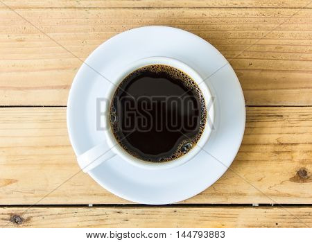 Coffee cup on wooden table background .
