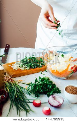 Woman On Kitchen Cuts Vegetables For Salad. Dieting And Detox Dr