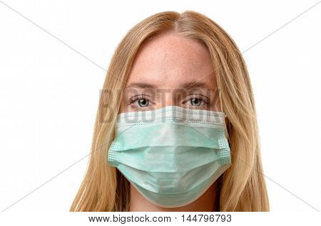 Frowning Young Woman Wearing A Face Mask