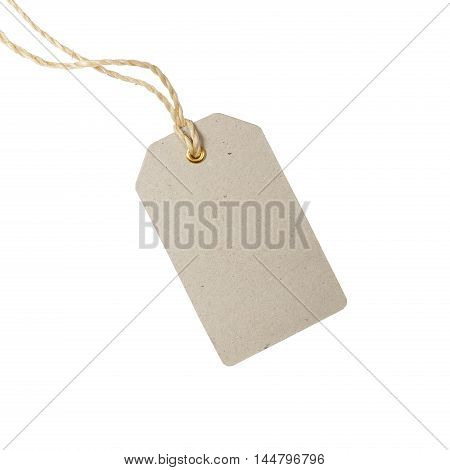 Empty tag on a string. Blank sale or price tag made of cardboard.