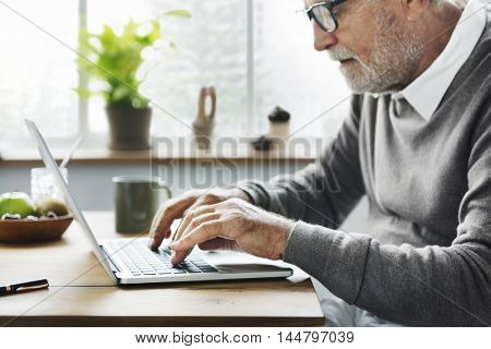 Senior Man using Digital Labtop Concept
