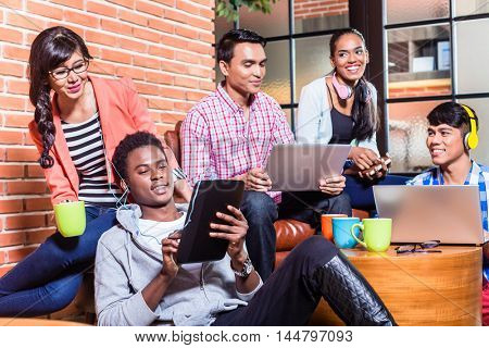 Group of diversity college students learning on campus, Indian, black, and Indonesian people
