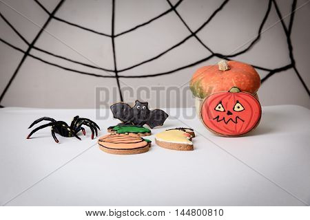 Halloween homemade gingerbread cookies and pumpkin ready for party
