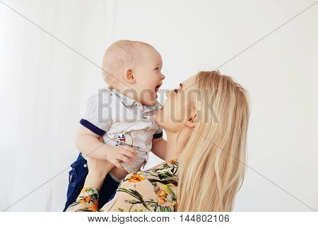 mother and young son laughing. The concept of family