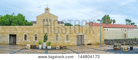 The stone facade of Church of the Multiplication of the Loaves and Fish located in Tabgha on the shore of the Sea of Galilee Israel.