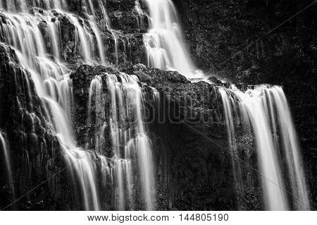 Beautiful waterfall in green forest black and white
