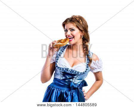 Beautiful Woman In Traditional Bavarian Dress Holding A Pretzel