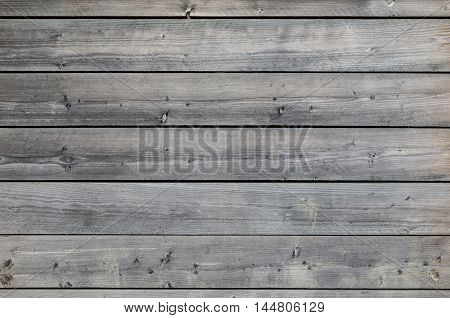 An old rustic weathered grey wooden background