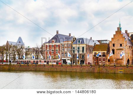Hague, Netherlands - April 5, 2016: Street view with dutch houses and lake in Hague, Holland