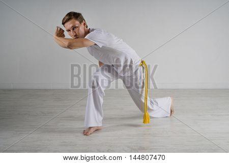 Man practicing capoeira , brazilian martial art.