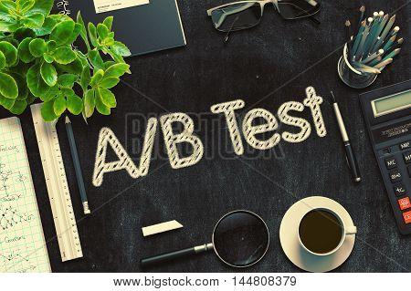 AB Test Handwritten on Black Chalkboard. . Toned Image.