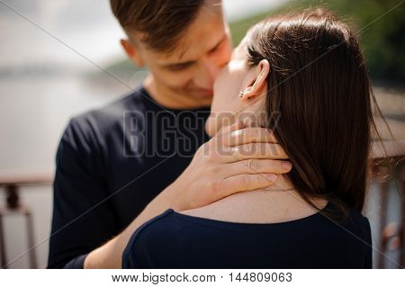 A young couple looking at each other with smile