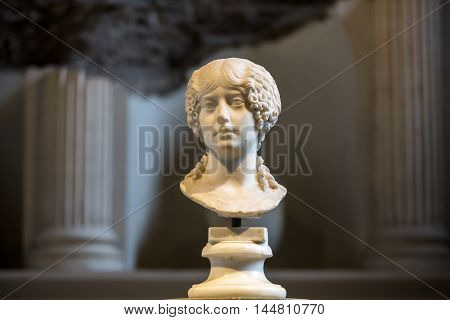 ROME, ITALY - JUNE 12, 2015: Ancient bust of the woman in the baths of Diocletian in Rome. Italy