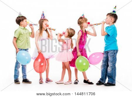 children with birthday hats and baloons using fifes udi