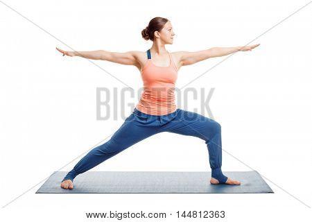 Woman doing Ashtanga Vinyasa Yoga asana Virabhadrasana 2 - warrior pose 2 isolated on white
