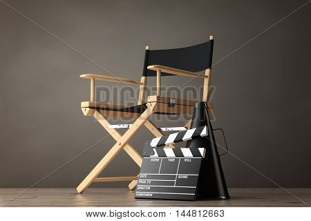 Director Chair Movie Clapper and Megaphone on a wooden floor. 3d Rendering