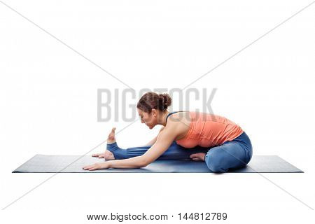 Young beautiful sporty fit woman doing Ashtanga Vinyasa Yoga asana Janu sirsasana A - head-to-knee pose A easy posture variation isolated on white