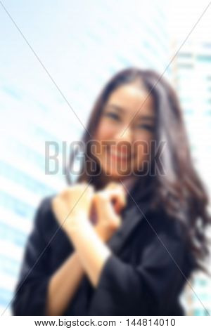 de-focused portrait of Asian youth business woman look brilliant and success on black suite