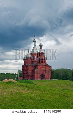 TVER OBLAST RUSSIA - JUNE 02 2016: Olgas ancient orthodox church of the 17th century at the source of Volga river Tver oblast Russia in June 2016
