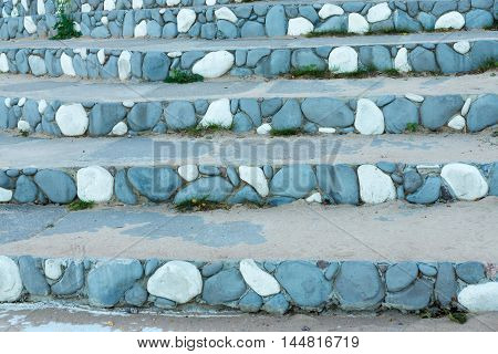 stone steps closeup with a spotty striped pattern of blue color for the abstract background or for wallpaper