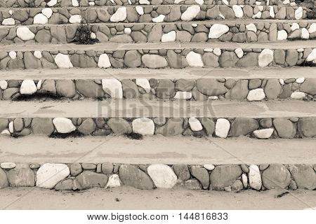 stone steps closeup with a spotty striped pattern of beige color for the abstract background or for wallpaper
