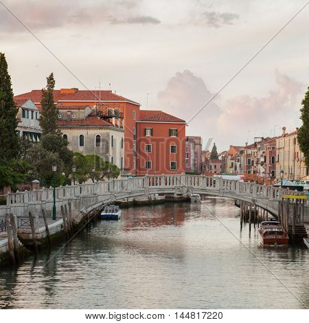 Canal Grande sunset of Accademia's bridge. Beautiful sky with gorgeous clouds. Venice, Italy.