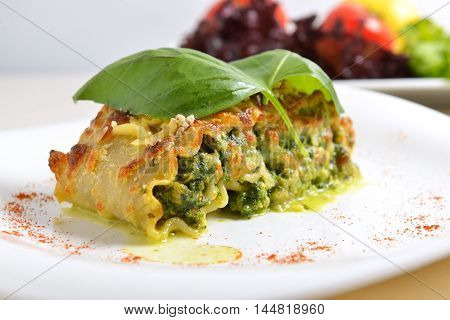 lasagna stuffed with spinach cheese sauce and a Basil leaf