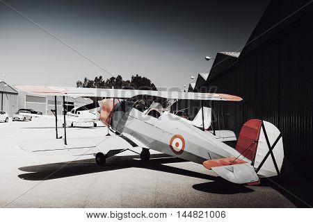 Old vintage plane parked at the aerodrome.