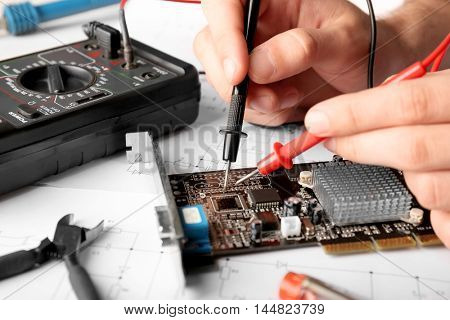 Man repairing video card, closeup