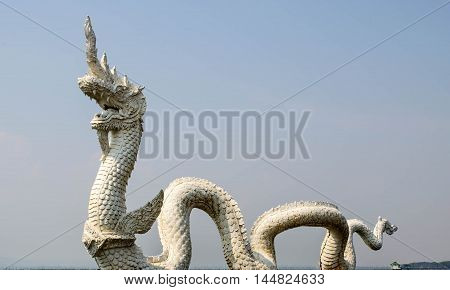 Thai dragon or king of Naga statue with blue sky