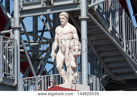 VITYAZEVO, RUSSIA - JUNE 9, 2013: Statue of Hercules at the entrance to the  water park