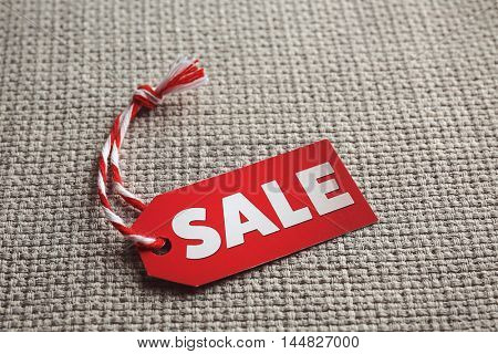 Sale label on fabric background