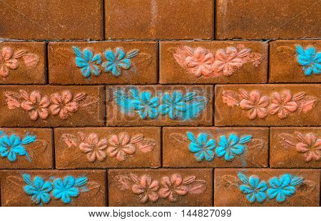 colorful floral carved brick wall texture and background