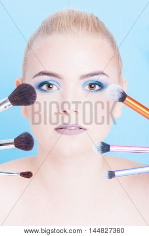 Portrait Of Beauty Make-up With Different Kinds Of Brushes