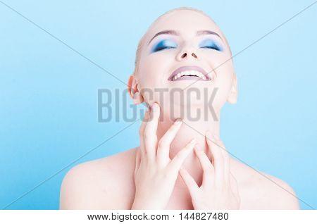 Girl Posing With Matching Blue Make-up And Polish