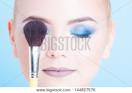 Close-up Of Lady Covering Eye With Make-up Brush