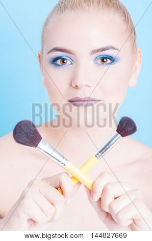 Portrait Of Girl Posing With Crossed Make-up Brushes