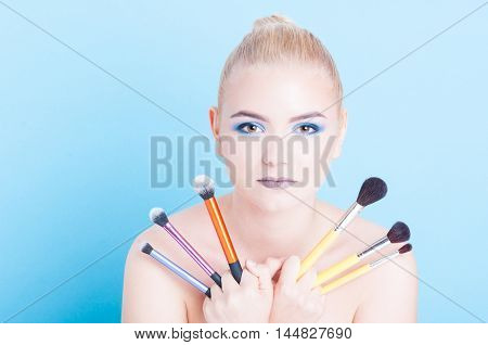Woman Posing With Bunch Of Professional Make-up Brushed