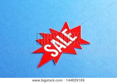 Sale label on color background