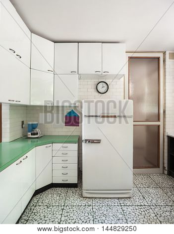 Old domestic kitchen of an apartment, vintage refrigerator