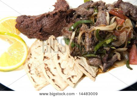 Beef Stir Fry With Mashed Beans And Tamales Nicaragua