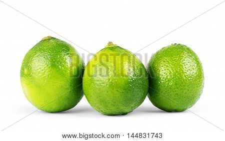 three limes isolated on white background close up