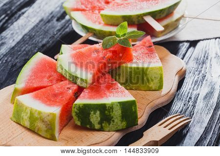 Top view.healthy watermelon on the black wooden background.